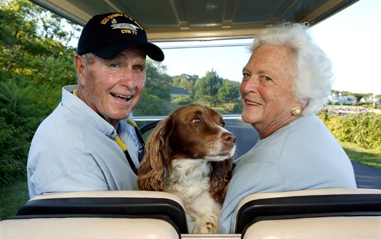 Former President And Mrs. George. H. W. Bush At Their Home In Maine With Dog Millie